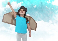 Dgital composite of smiling kid pretending to be a pilot against clouds