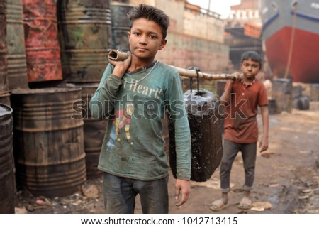 DHAKA - BANGLADESH - JANUARY 17, 2018: Unidentified child worker in a shipyard on January 17, 2018 in Dhaka, Bangladesh. Bangladesh has over 4.7 million child workers aged between 5 to 14.