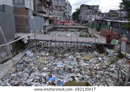 DHAKA, BANGLADESH - JULY 22, 2017: A canal full with wastage and plastic materials in Dhaka, Bangladesh on July 22, 2017. #682130617