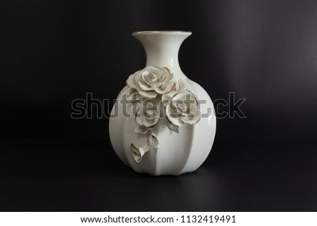 Dhaka, Bangladesh - July 12 2018: Beautiful Solid White Rose Flower Vase with Black Background