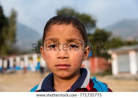Dharamshala, India - November 20, 2017: A young poor Indian boy. #771735775