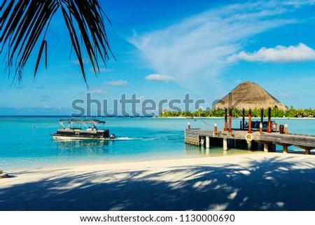 DHIGU, MALDIVES - JUN 24, 2018: Welcoming point of Anantara resort on Dhigu island on Jun 24, 2018. #1130000690