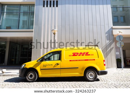 DHL Volkswagen delivery car during service in front of office building in bright sunny day in Sofia, Bulgaria, October 5, 2015.