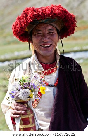 DHO TARAP, NEPAL - SEPTEMBER 11: An unidentified smiling Tibetan Rnying-ma-pa monk posing for a photo during Full Moon Festival on September 11, 2011 in Dho Tarap Village, Dolpo district, Nepal