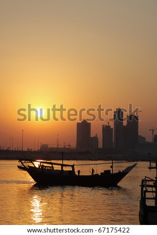 Dhow moving out to the sea during sunset