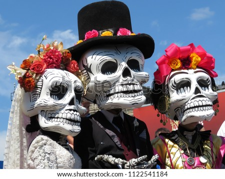 Dia de los Muertos, Day of the Dead. Participants of the Mexican holiday in death masks