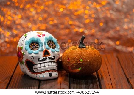 Shutterstock Dia De Los Muertos Halloween Celebration Background With Sugar Skull And Orange Pumpkin. Selective Focus With Copy Space.