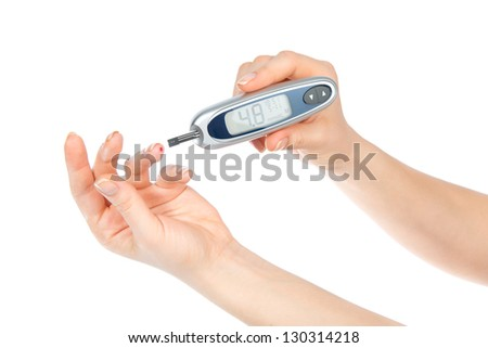 Diabetes concept. Measuring glucose level blood test using ultra mini glucometer and small drop of blood from finger and test strips isolated on a white background