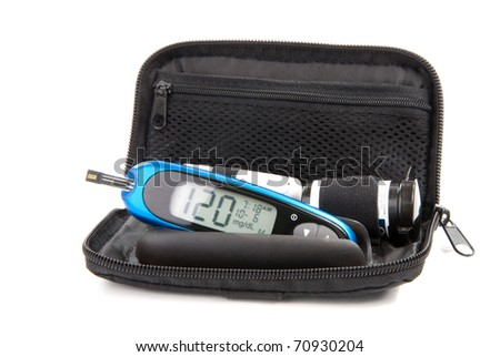 Diabetes glucose level blood test using ultra mini glucometer kit and small drop of blood from finger and test strips isolated on a white background. Device shows 120  mg/dL which is normal