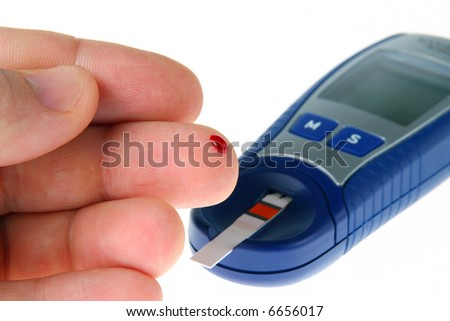 Diabetic is doing a glucose level finger blood test - stock photo