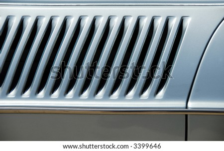 Diagonal louvred air vent on a metallic light blue car from the seventies #3399646