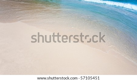 Diagonal of sand and wave background