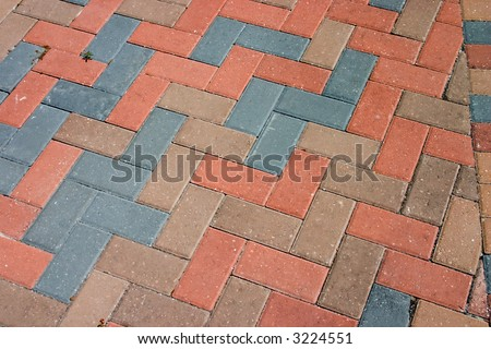 diagonal pattern of brick pavers in a Herringbone style - stock photo