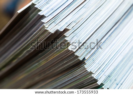 diagonal view of a pile of magazines - stock photo