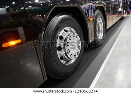 Diagonal view on new chrome bus wheels and black tires. Intercity tree axles heavy bus rear wheel on chassis. Commercial transport wheels concept  #1210668274