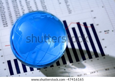 Diagram and glassy globe.Finances concept