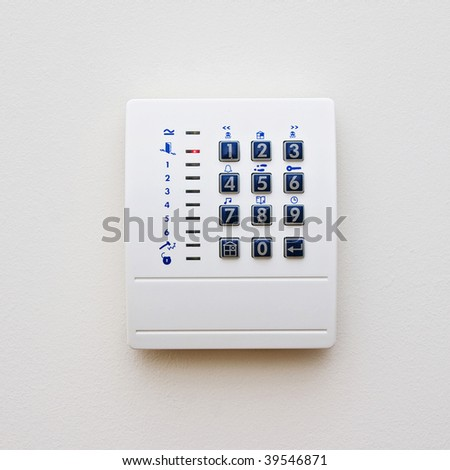 dial of a domestic property alarm with function buttons - stock photo