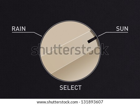 Dial switch to change from rain to sun - stock photo