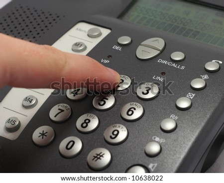 Dialing number on a telephone - stock photo