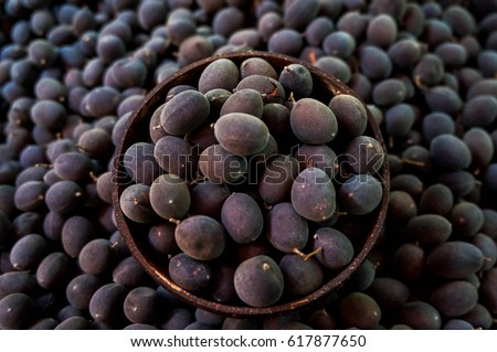 dialium cochinchinensis or velvet tamarind fruit in  basket #617877650