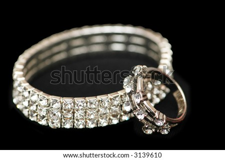 Diamond bracelet and ring isolated  on black