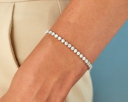 Diamond bracelet on young woman hand