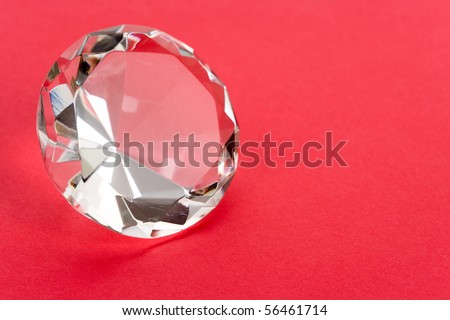 Diamond close up shot with red background