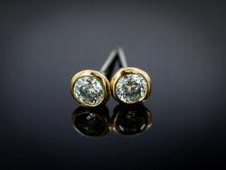 Diamond earring on gradient black background