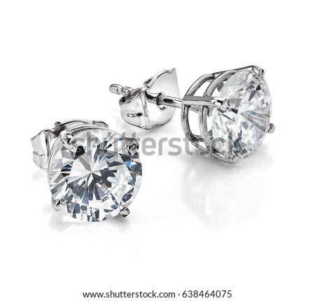 Diamond earrings. Big diamond earrings, large solitaire earrings on white background. Four prong, four claw diamond earrings with posts and backs. Round brilliant cut diamonds.