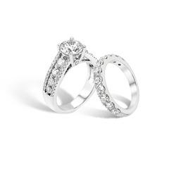 diamond engagement ring and diamond eternity band ring group on white background