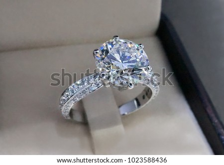 Photo of  Diamond engagement ring isolated in box.
