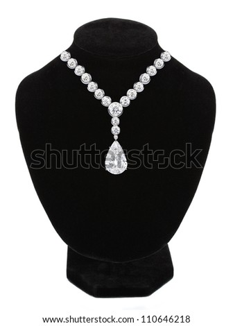 Diamond necklace on black mannequin isolated on white background