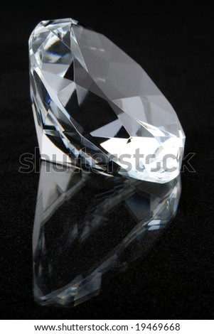 Diamond on black reflective surface