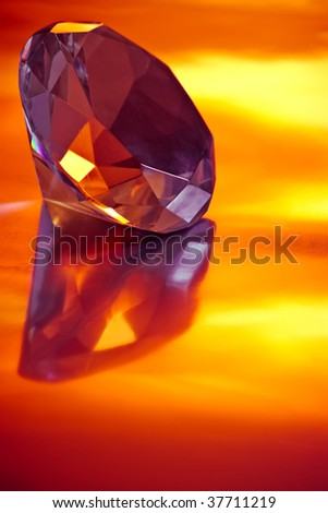 diamond on reflective surface in yellow light