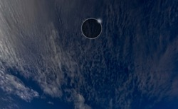 Diamond ring, Baily's bead and corona of total sun eclipse that behind fluffy cirrus cloud