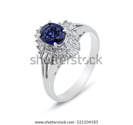 Diamond ring. Diamond ring with sapphire isolated on white background. Ring with diamonds and  large sapphire. Golden wedding rings.  #521104183