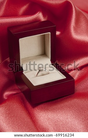 Diamond ring in a box over silk background - stock photo