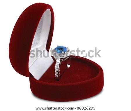 diamond ring in red velvet box isolated on white background