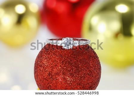 Diamond ring on Christmas decorations #528446998