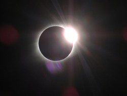 Diamond ring phenomenon occurring at the end of totality during the 2017 Great American Solar Eclipse. Photo taken in southern Illinois.