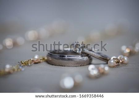 Diamond Ring. Wedding Ring | Closeup view of wedding diamond ring on a table