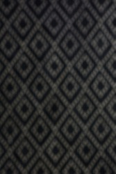 Diamond shape background, Seamless harlequin or argyle pattern made of black diamonds over white. Grid, mesh, lattice background with rhombus, diamond shapes. Blurry texture. Monochrome.
