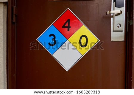 Diamond shaped NFPA panel identifying hazardous chemicals inside. This sign informs firefighters there is zero reactivity hazard, fire flash point below 73-deg and health hazard is extremely dangerous