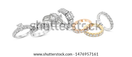 diamond stacked rings group on white background,white gold,yellow gold,rose gold stock photo