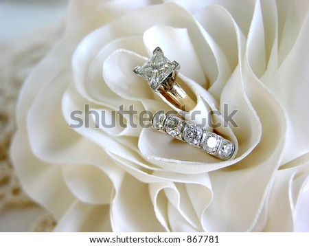 stock photo diamond wedding rings in the folds of the bride 39s dress