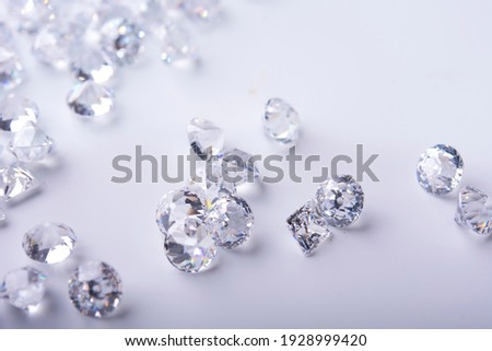 Diamond with tweezers and magnifier.Gemstone Beauty