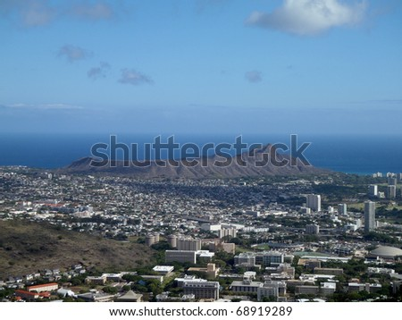Diamondhead and the city of Honolulu of Oahu on a nice day.  UH Manoa and the H-1 Visible - stock photo