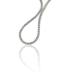 Diamonds necklace close up on white background with reflection