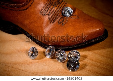 Diamonds with a cowboy boot on wood.