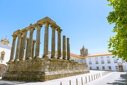 Dianna Temple and cathedral tower in Evora. Ancient roman temple in the old city of Evora, Portugal